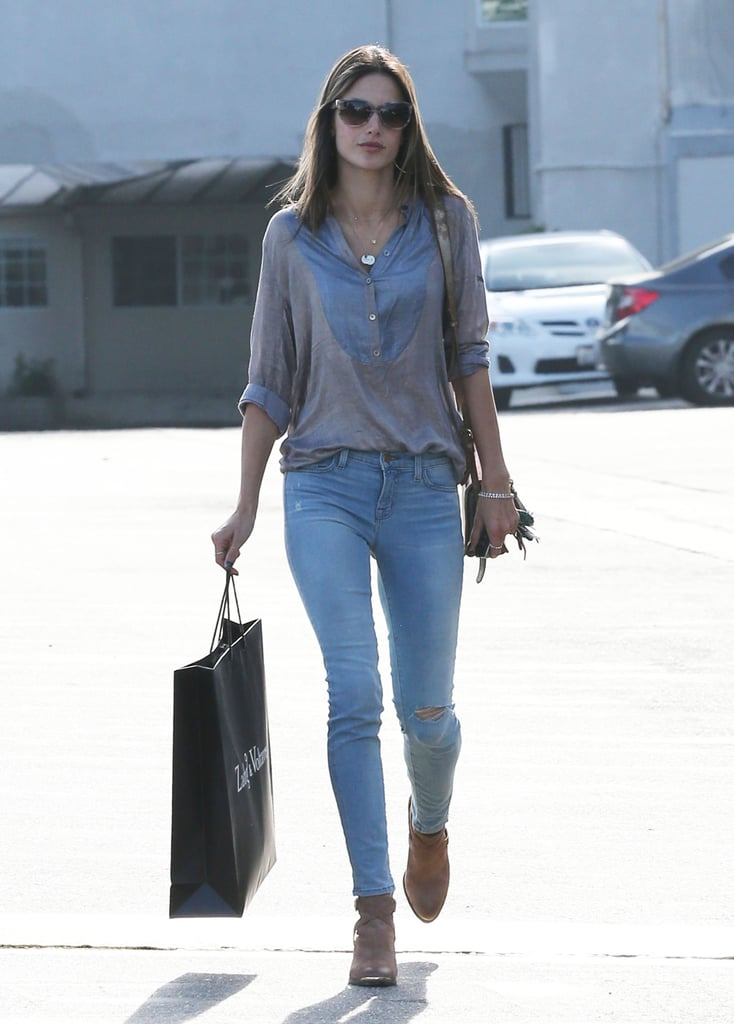 Alessandra Ambrosio shopped at Zadig & Voltaire in West Hollywood in a casual collared blouse with light-wash skinny jeans and Aldo tan ankle boots.
