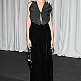 Karolina Kurkova made an entrance in her dramatic pleated design at the amfAR event in Milan.