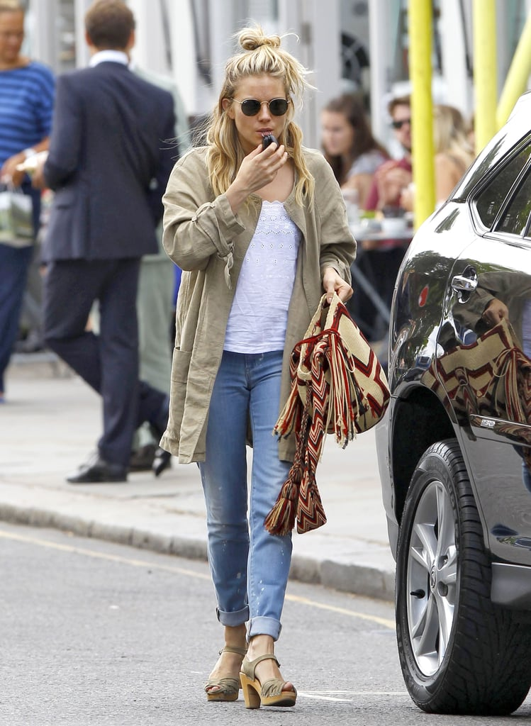 Sienna Miller wore a green jacket while out in London.