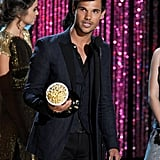 Taylor Lautner accepted his award.