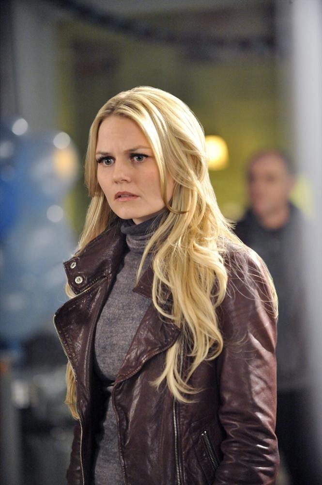 Emma looks concerned.
