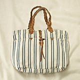 For a vintage Americana look, try this nautical-inspired tote with yarn-dyed stripes and braided leather straps.  Rugby Blue Striped Large Tote ($98)