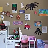 I displayed their artwork on our playroom walls with double-sided tape.