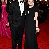 Emily Blunt chose a Carolina Herrera black gown with a subtle keyhole, then added Lorraine Schwartz shield earrings for a dramatic effect.