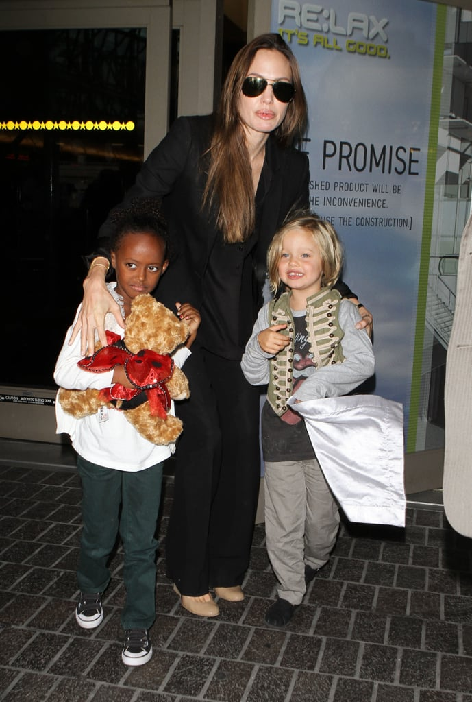 Angelina Jolie arrived at LAX last night holding hands with her eldest daughters Zahara and Shiloh. The girls are returning from a trip with Angelina while their brothers, Maddox and Pax, tagged along with Brad Pitt on a trip to Mexico earlier in the week. Brad promoted Moneyball at the Cancun Film Festival while Pax and Maddox hit the beach. It's been a big month for the Jolie-Pitt family, they've been traveling around the globe to exotic set locations and just yesterday was Knox and Vivienne Jolie-Pitt's third birthday! There are also reports swirling that Angelina and Brad may be finally ready to tie the knot this Summer, though most of you think it's probably another false rumor.