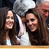 Pippa and her sister Kate whispered between sets at the men's Wimbledon finals in July this year.