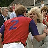 William greeted Camilla with a kiss during the Burberry Cup in England in June 2005.