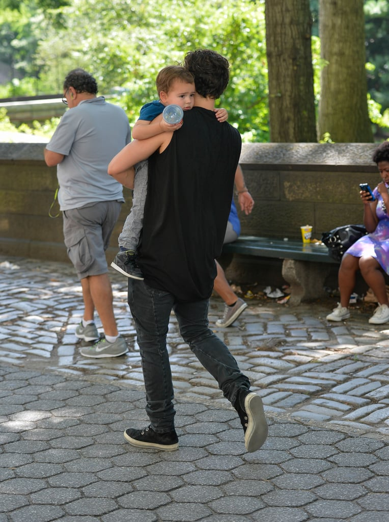 Orlando carried Flynn through the park on July 6.