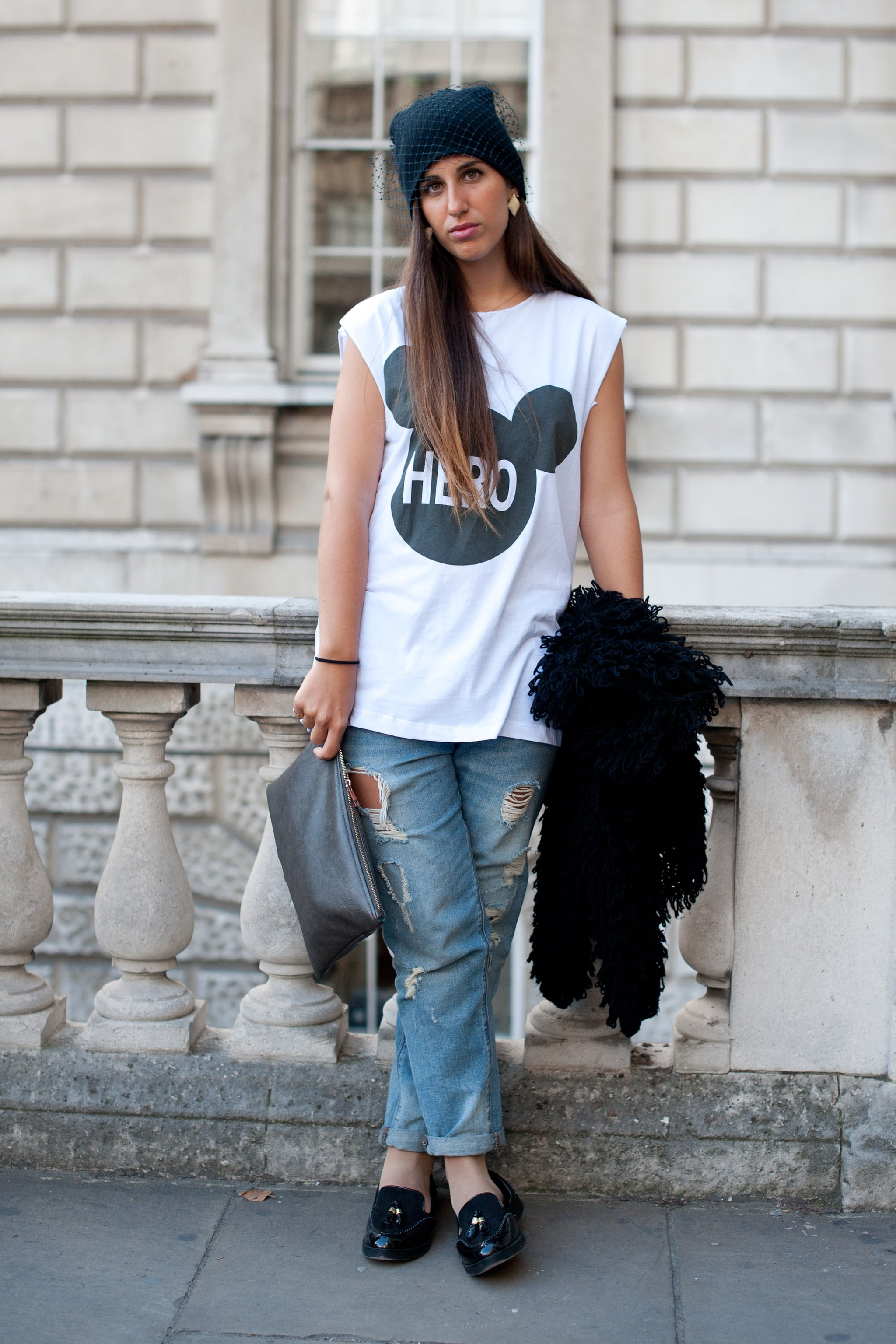 Unexpected (and refined) details like a veiled beanie and tasseled loafers can provide a jeans ensemble with just the right amount of off-duty polish.