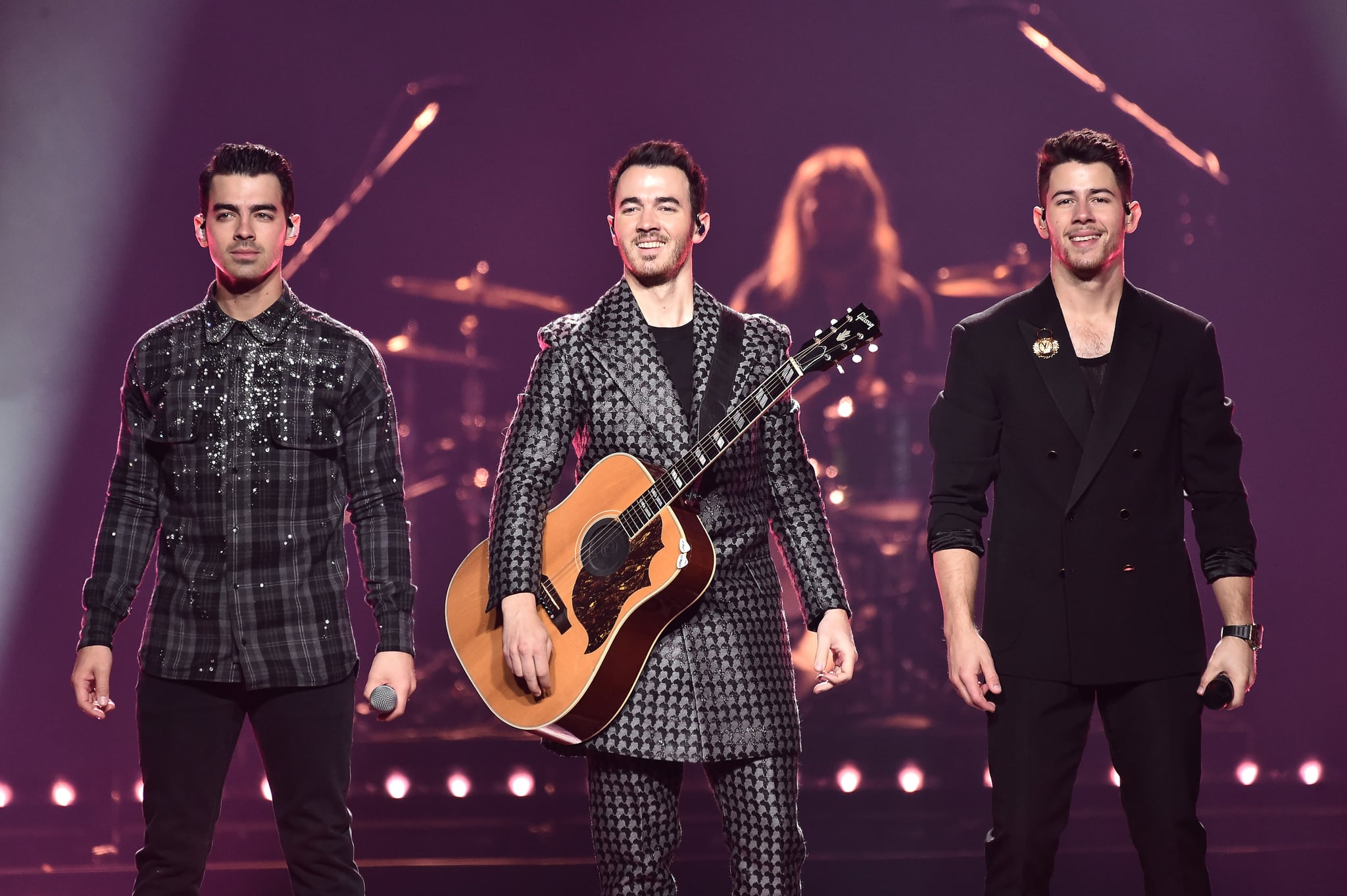 NEW YORK, NEW YORK - NOVEMBER 23: Joe Jonas, Kevin Jonas, and Nick Jonas of The Jonas Brothers perform at Barclays Center on November 23, 2019 in New York City. (Photo by Steven Ferdman/Getty Images)