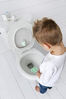 This Bullseye Light For the Toilet Bowl Might Be the Most Clever Potty-Training Tool We've Seen