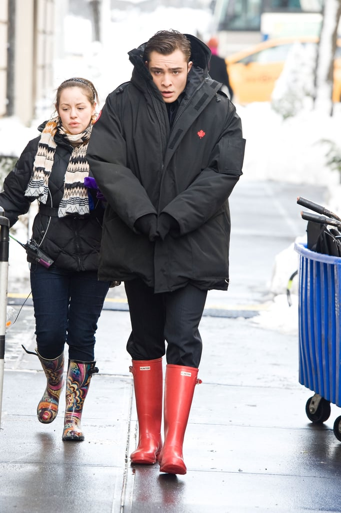 The Gossip Girl cast were out on the streets of NYC in force yesterday as they filmed the series in the snow. Ed Westwick was almost enveloped in his big coat as he made his way to set, and wore some eyecatching bright red wellies. He's not just concentrating on all things gossip right now though, Ed's got an exciting role in a new Clint Eastwood film coming up. Blake Lively looked gorgeous as ever even with her hair in curlers, while Leighton Meester and Penn Badgley looked freezing under all their layers. Jessica Szohr had a smile for the cameras though — ICYMI, she and Ed are featured in our slideshow all about American women falling for British rockers!