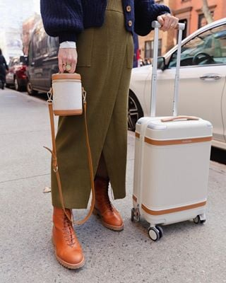 14 Carry-On Suitcases Frequent Flyers Always Buy and You Should, Too