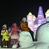 Kids played on some of the snow sculptures at the Grand Ice and Snow World.