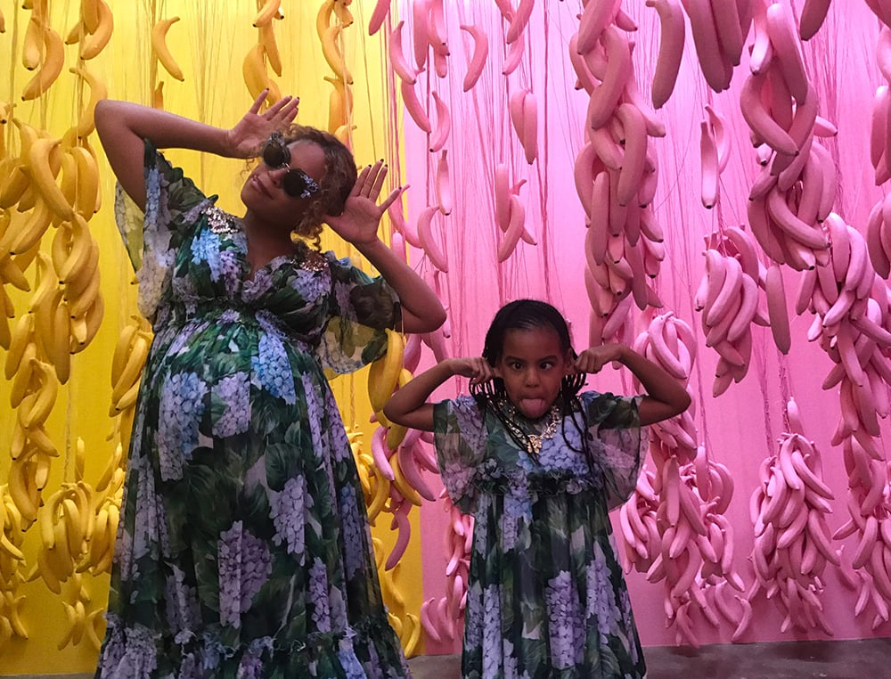 As we anxiously await the arrival of Beyoncé and Jay Z's twins, Queen Bey herself decided to share a series of family photos from her recent Mother's Day celebration on her website on Friday. Beyoncé, Jay Z, and daughter Blue Ivy all visited the new Museum of Ice Cream in LA along with Beyoncé's mom, Tina Lawson. The fun visit also doubled as Apple Martin's 13th birthday, and from the looks of it, they had a blast. Not only did Beyoncé and Blue wear matching Dolce & Gabbana dresses, but the brood was all smiles as they played on a swing set and tossed a ball around in a giant pool of sprinkles. We wonder if they ran into Nicole Richie and her family?