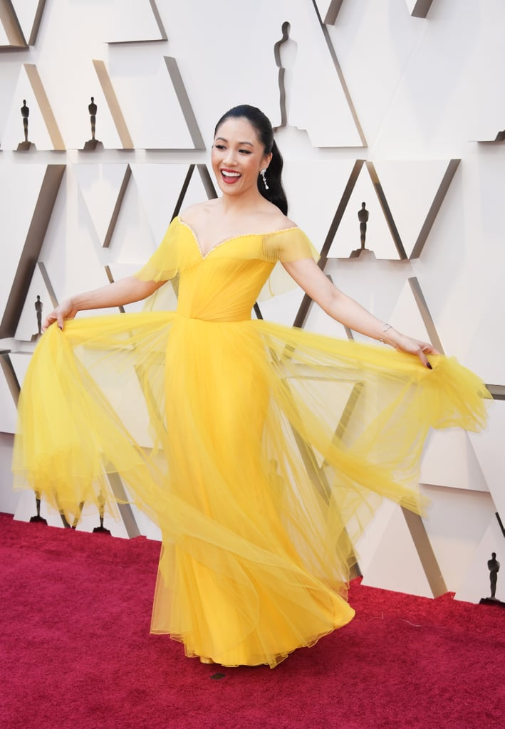 The 91st Academy Awards rolled through Hollywood on Sunday, and you bet the cast of Crazy Rich Asians came dressed to impress. Constance Wu channeled her inner Rachel Chu in a gorgeous yellow Belle-esque gown and Awkwafina kept things cool in a sparkly suit. The ladies were joined by the rest of the cast, including Henry Golding, Michelle Yeoh, and director Jon M. Chu. Even though Crazy Rich Asians was completely shut out of this year's Oscar nominations (can you believe it?!), Awkwafina and Wu had the honor of presenting, and according to Yeoh, they'll all be letting loose later at the Warner Bros. afterparty.       Related:                                                                                                           Who's Nominated For an Oscar This Year? Brush Up on the Nominations