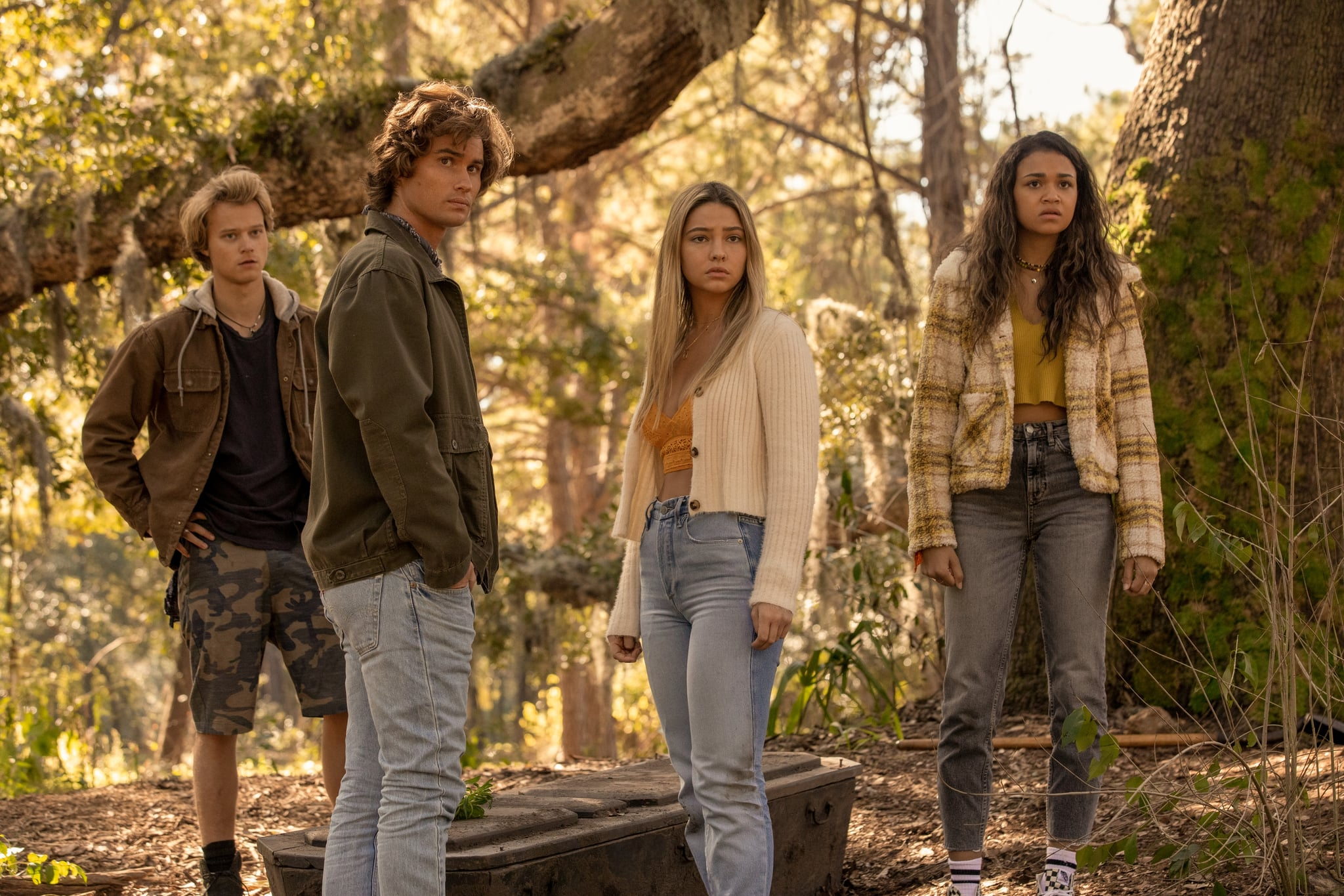 OUTER BANKS (L to R) RUDY PANKOW as JJ, CHASE STOKES as JOHN B, MADELYN CLINE as SARAH CAMERON, and MADISON BAILEY as KIARA in episode 208 of OUTER BANKS Cr. JACKSON LEE DAVIS/NETFLIX  2021