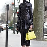 Hold their gaze with a sequined outfit or top and add final shock with bright pink mules.
