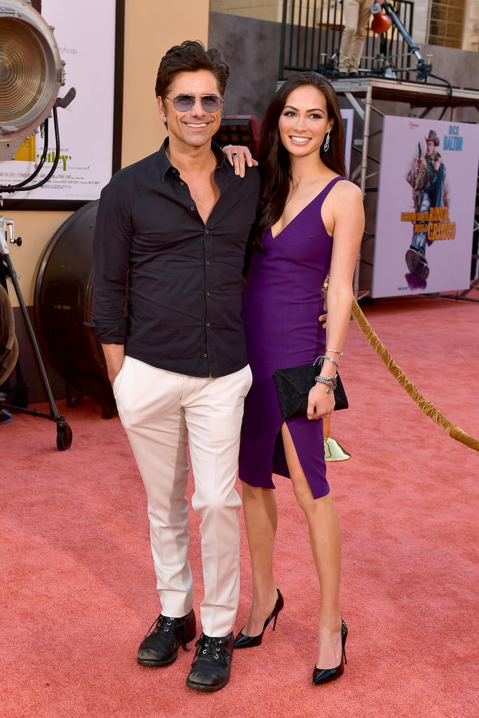 John Stamos and Caitlin McHugh at the Once Upon a Time in Hollywood LA premiere.