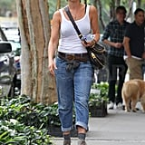 Jennifer wore trendy boots and a white tank for her day out on the town.