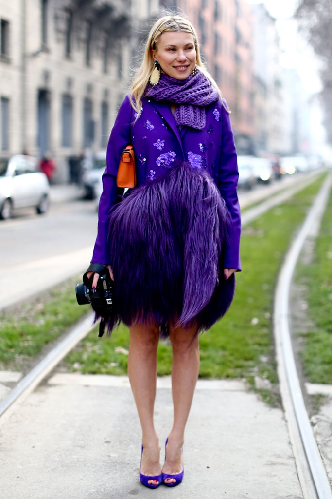 Between the feather trim and bold purple hue this kind of coat was made for Fashion Week.