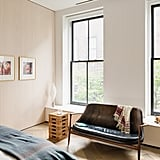 Phillip's bedroom is a serene retreat from the hectic city below. Phillip decorated the space himself.