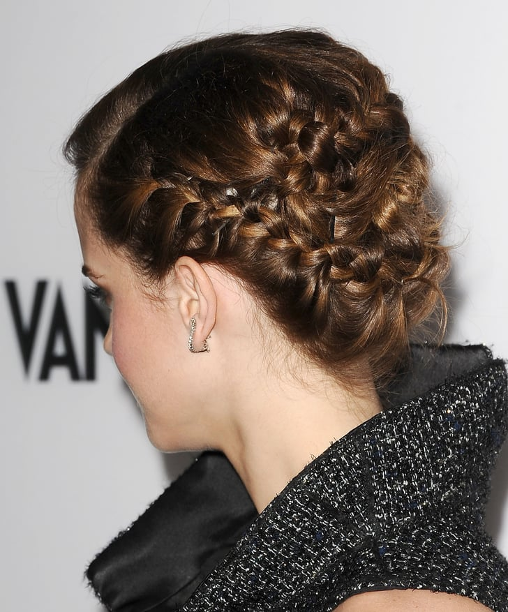 From the back, Emma's updo was an intricate braided style ...