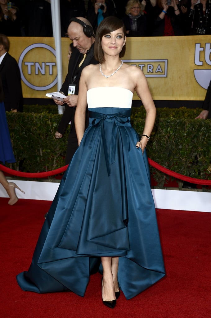 Marion Cotillard wowed in Dior Haute Couture number with an ivory silk top and dark green skirt. She accessorised with black pointed pumps, black nail polish, and a diamond Chopard necklace.