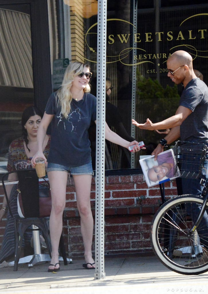 Kirsten Dunst stopped to talk to an onlooker while getting coffee in LA.