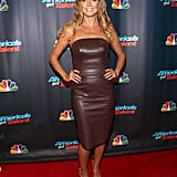 Heidi Klum lathered up in leather at an America's Got Talent event in NYC. Gold drop earrings coordinated with her brown dress perfectly.
