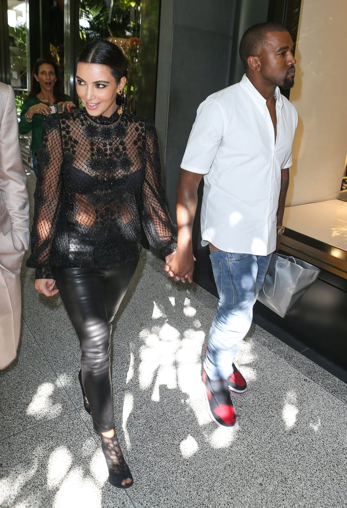 Kim Kardashian wore a sheer, beaded top with a black bra as she stepped out with Kanye West, Kourtney Kardashian, and Scott Disick yesterday in Miami. The foursome was spotted toting shopping bags from Neiman Marcus while strolling the city's luxe Bal Harbour Shops. They also made a stop for lunch at Makoto, a restaurant inside the mall.  Kim and Kanye are back in Florida, where she and Kourtney are taping their E! reality show, after making a trip to Rome earlier this month to celebrate Kim's 32nd birthday. The pair went shopping and dined out to mark the milestone. Kim and Kanye don't only wait for special occasions to take romantic getaways, however. Since they began dating, they've traveled to Paris, Cannes, and Mexico, just to name a few destinations.