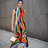 Work a colorful pair with an equally vibrant, floor-skimming dress.