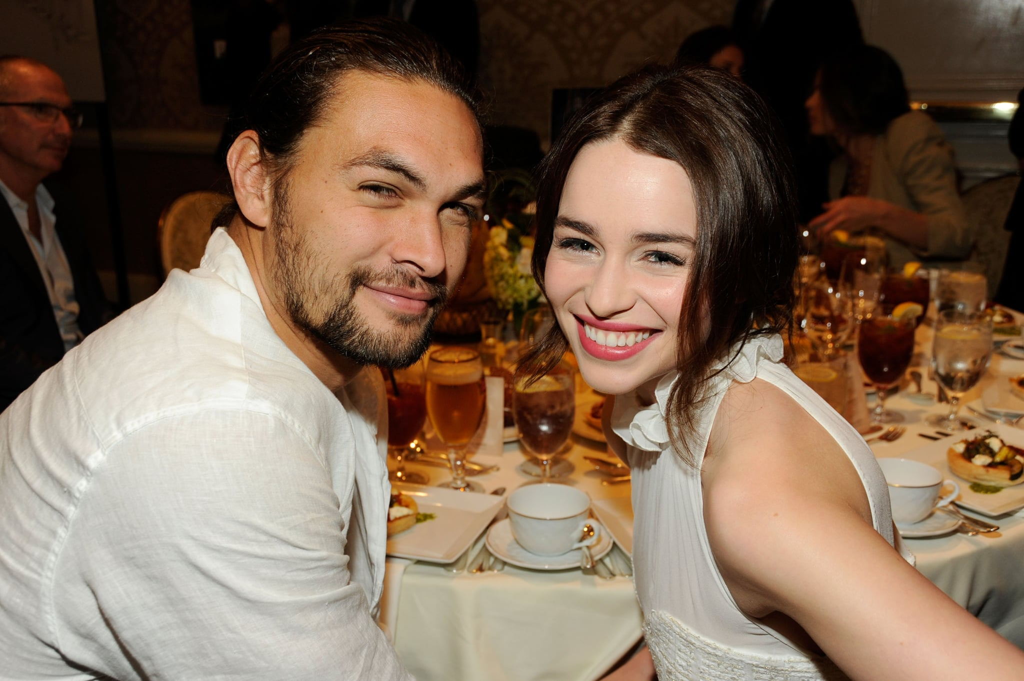 BEVERLY HILLS, CA - JANUARY 13:  Actor Jason Momoa (L) and actress Emilia Clarke attend the 12th Annual AFI Awards held at the Four Seasons Hotel Los Angeles at Beverly Hills on January 13, 2012 in Beverly Hills, California.  (Photo by Frazer Harrison/Getty Images for AFI)