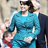 In June 2013, Eugenie wore a turquoise ensemble with a small cream hat, and carried a studded clutch.