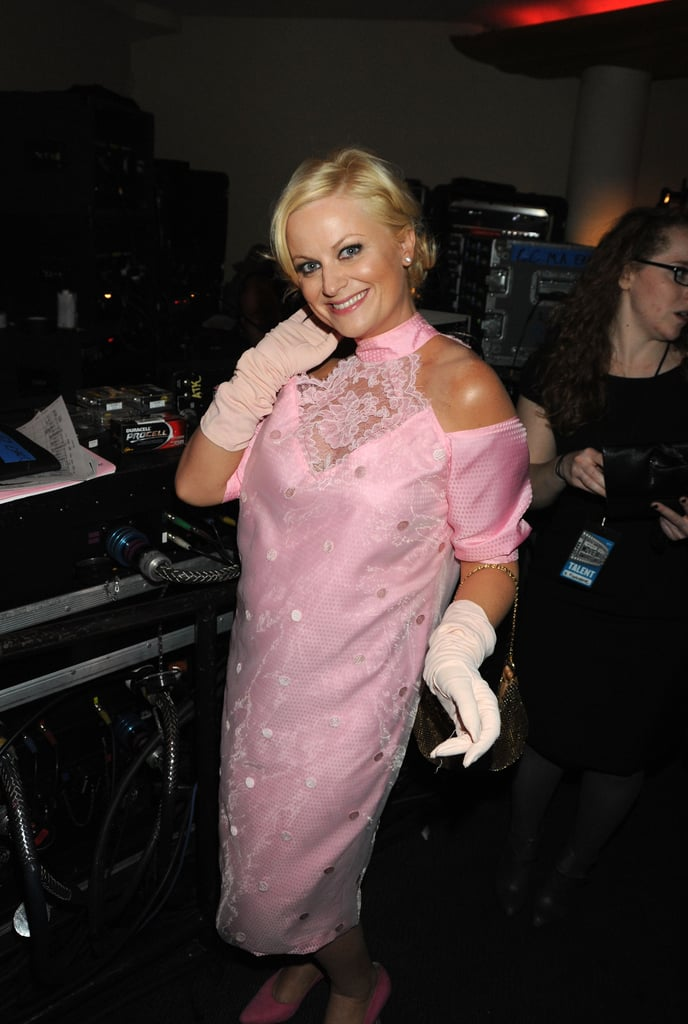 Amy Poehler joked around backstage before paying tribute to director John Hughes during the 2010 show.
