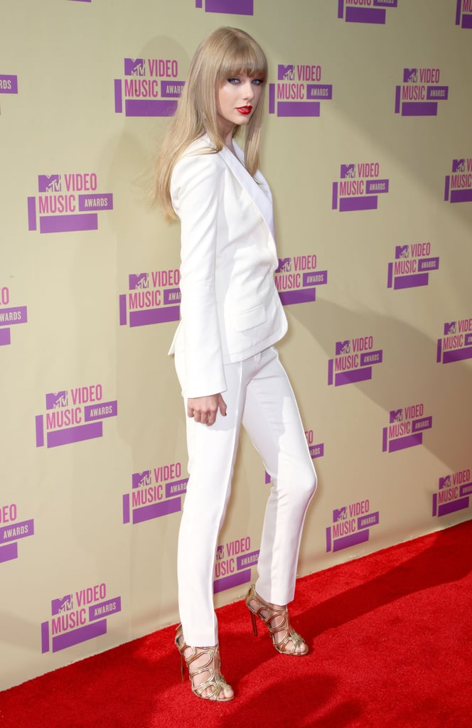 "Taylor Swift opted for a white pantsuit to make her red-carpet entrance at the VMAs in LA tonight. She'll be taking the stage later this evening to perform her latest hit, ""We Are Never Ever Getting Back Together"" from her upcoming album Red due out Oct. 22. Taylor isn't up for any Moonmen this year, but we all remember the moment Kanye West stormed the stage during her best female video acceptance speech in 2009. The night's just getting started — stay tuned as we bring you more news and photos from the red carpet and inside the show."