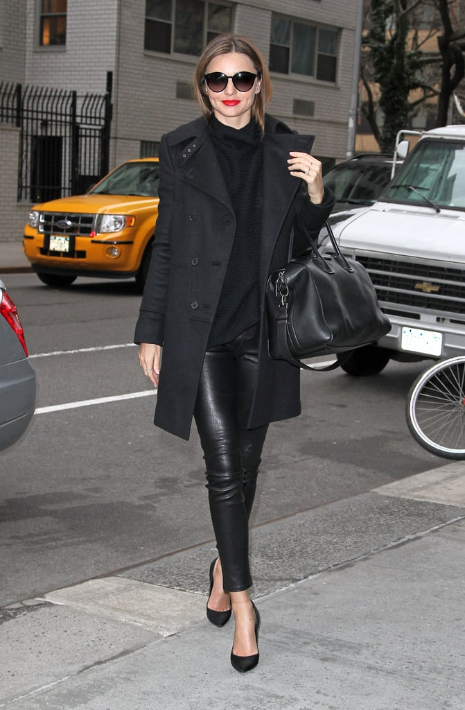 Proving all-black is anything but boring, Miranda Kerr rugs up in style thanks to leather leggings and a form-fitting coat.