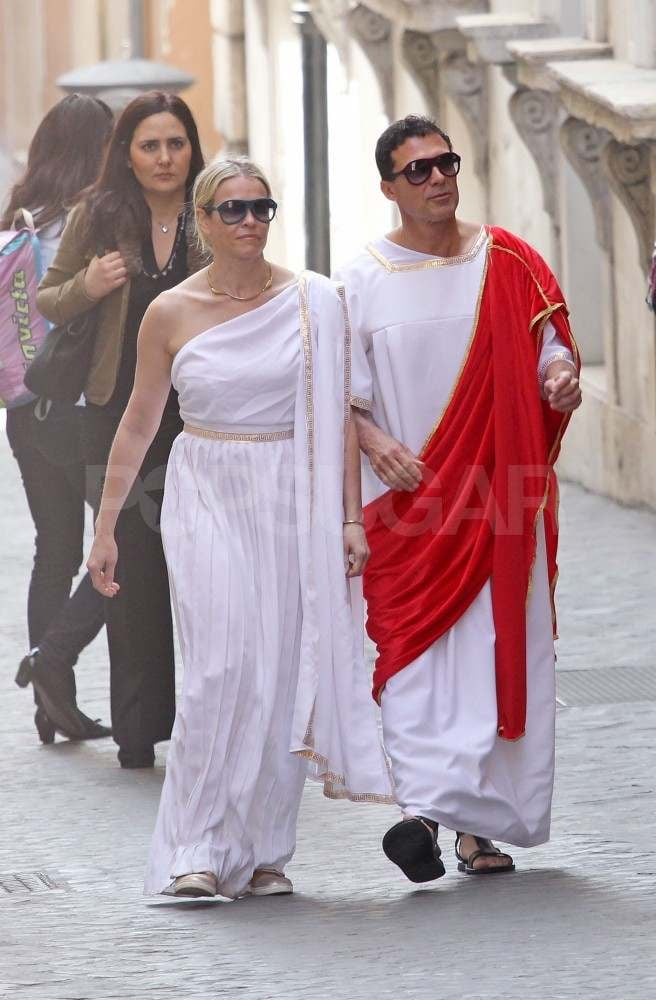 Chelsea Handler and her on-again boyfriend, Andre Balazs, got festive during their trip to Rome on Wednesday. The couple, who are back together after splitting in November 2011, wore toga-inspired outfits to tour the city. Chelsea and Andre visited the Galleria Borghese Museum, relaxed on a bench in the garden, and then doubled up on a Vespa to ride to dinner. On Tuesday they were spotted snapping pictures while checking out Marcello's Roman theater, Piazza Navona, and the Pantheon. The vacation comes a week after the finale of Are You There, Chelsea? aired on NBC to wrap up its first season. Chelsea is still on the small screen, though, with her Chelsea Lately and After Lately talk shows still running.