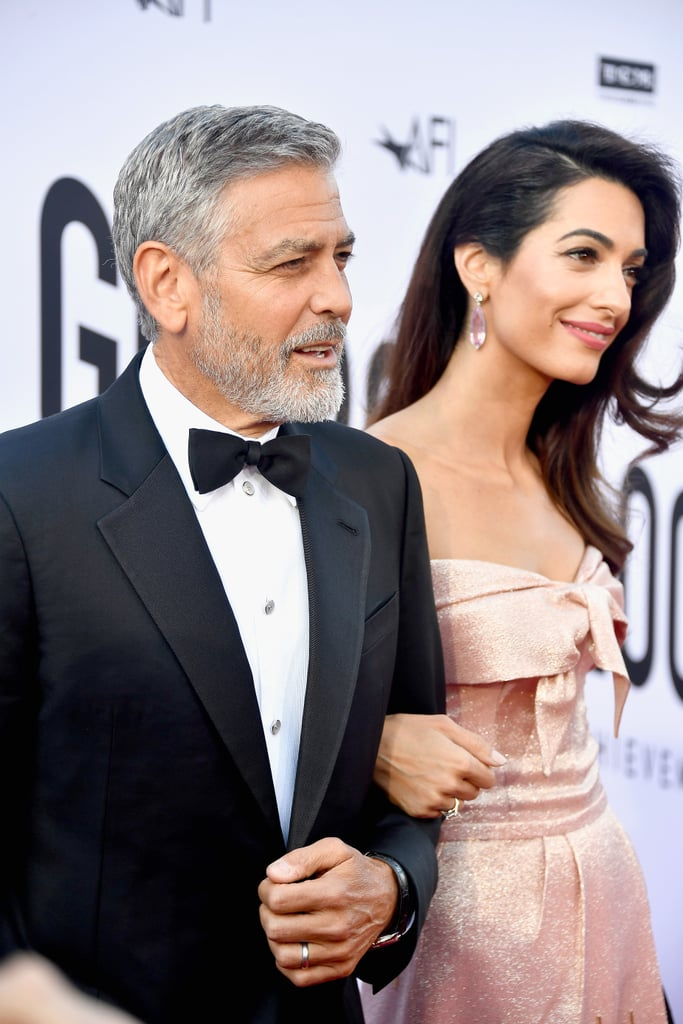 Following glamorous appearances at the Met Gala and then the royal wedding, we're starting to realise that George and Amal Clooney don't have regular dates. In their latest outing, the couple appeared at the AFI Life Achievement Award Gala Tribute on June 7 in Los Angeles. In fact, the 57-year-old actor was the guest of honour as this year's recipient of the esteemed award. Looking like they just stepped out of Old Hollywood, George wore a classic tuxedo, while Amal wore a dazzling pink — dare we say rose gold? — gown. The pair, parents to twins Alexander and Ella, looked like they had a great time, too, as they giggled all along the red carpet and lovingly looked at each other in that way they often do. Ahead, enjoy pictures from their classy evening.