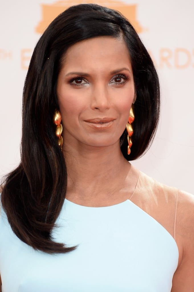 Metallic was the uniting thread in Padma Lakshmi's makeup look. She wore a silvery blue shadow on her lids and a coppery lip gloss.