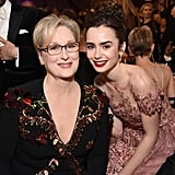 Meryl Streep and Lily Collins posed for a cute photo inside in 2017.