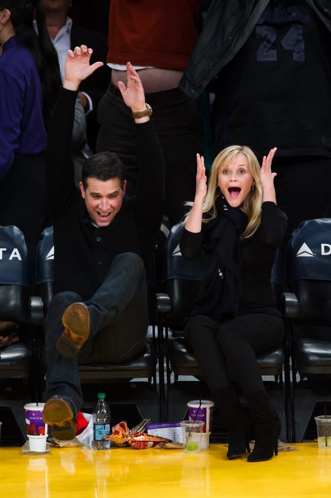 Reese Witherspoon and her husband, Jim Toth, showed a range of emotions last night at the Lakers game. The couple was courtside to watch as the home team took on the visiting Toronto Raptors and managed a 118-to-116 win. Reese, who had popcorn and lemonade during the matchup, made a handful of funny faces, while Jim threw his hands in the air after one suspenseful moment. Reese and Jim are back together after she got out of town earlier this week. Reese went to Mexico on a bikini-filled girls getaway to Mexico with friends Drew Barrymore and Cameron Diaz. They were at Tulum's Amansala Resort for a bikini boot camp, balancing their fitness classes with some fun beach time.