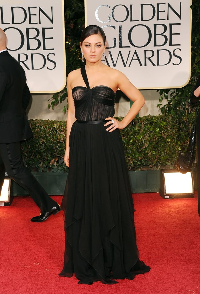 Mila Kunis chose a sexy black Dior gown for tonight's Golden Globe Awards in LA. She accessorized with jewelry from Cartier. Mila is presenting at this year's show after being a nominee for Black Swan in 2011. She's just one of many glamorous ladies on the red carpet, including Reese Witherspoon, Angelina Jolie, Lea Michele, and more. Make sure to vote on all of Bella and Fab's beauty and fashion polls!