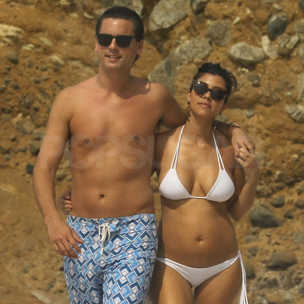 Scott put a loving arm around Kourtney.