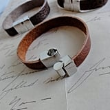 Handcut and created from upcycled leather, these skinny cuffs remind us of a classic Hermès bracelet. Leather Bracelet Cuff ($18)
