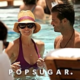 Brooke Burke and her husband, David Charvet, cozied up in the pool in Miami in July 2012.