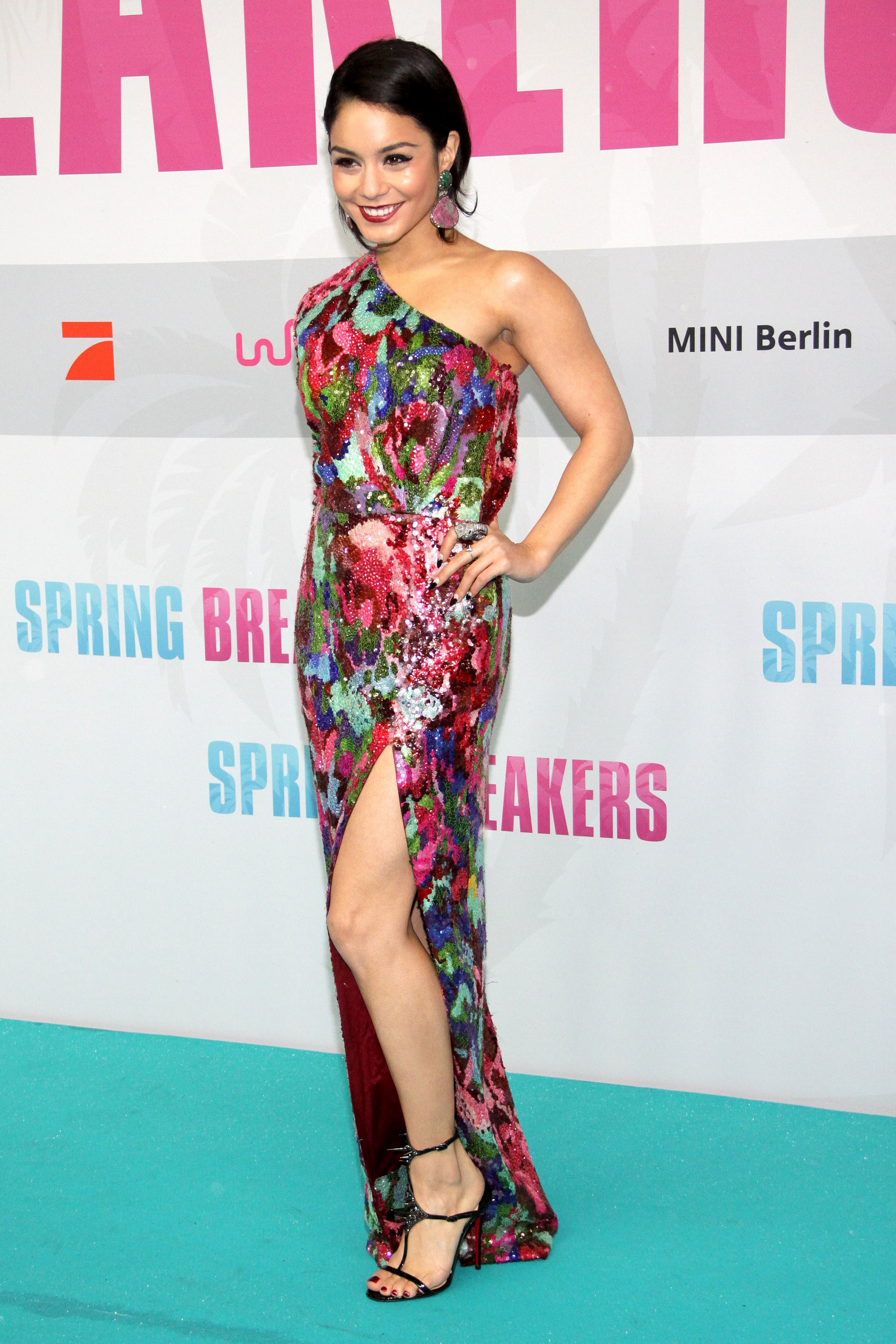 Vanessa Hudgens chose a colorful one-shoulder Naeem Khan sequined gown with a thigh-high slit paired with Christian Louboutin sandals for the Berlin premiere of Spring Breakers.