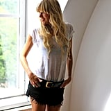 For an off-duty take on black-and-white dressing, try on this semisheer t-shirt and ripped denim cutoff look.