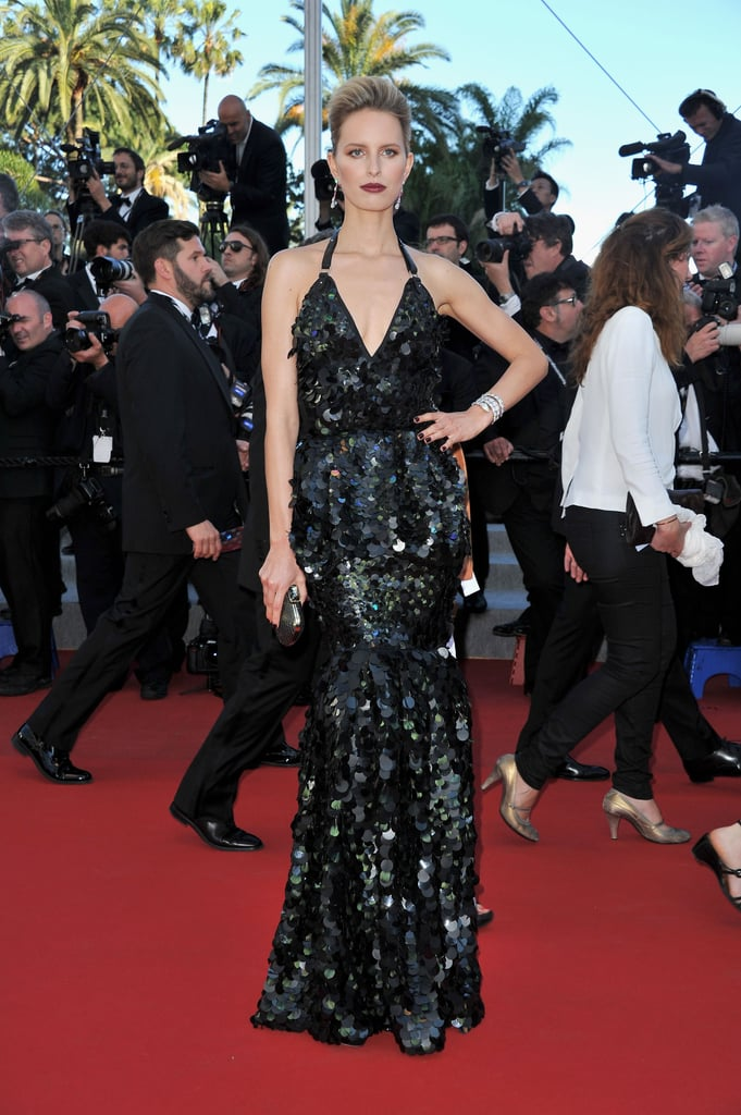 Karolina Kurkova channeled her inner mermaid in a sexy, form-fitted black halter dress, complete with a shiny embellished scale-like finish on the Killing Them Softly red carpet.