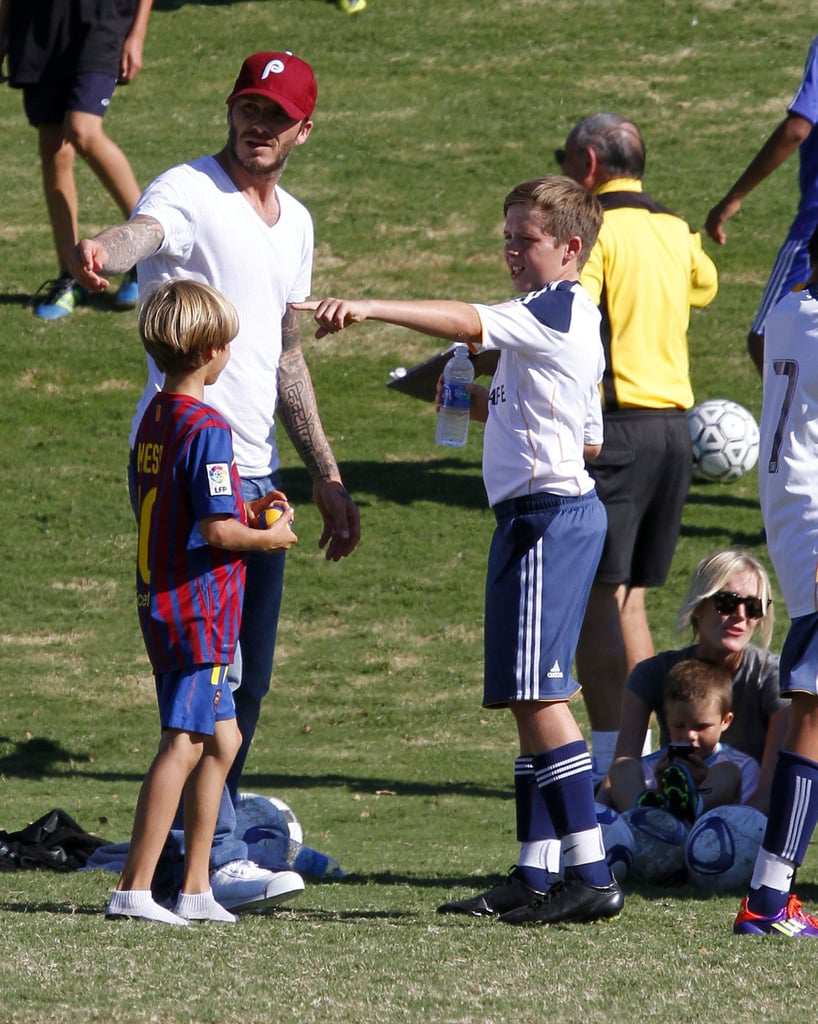 David Beckham and Brooklyn Beckham gave direction to Romeo Beckham.